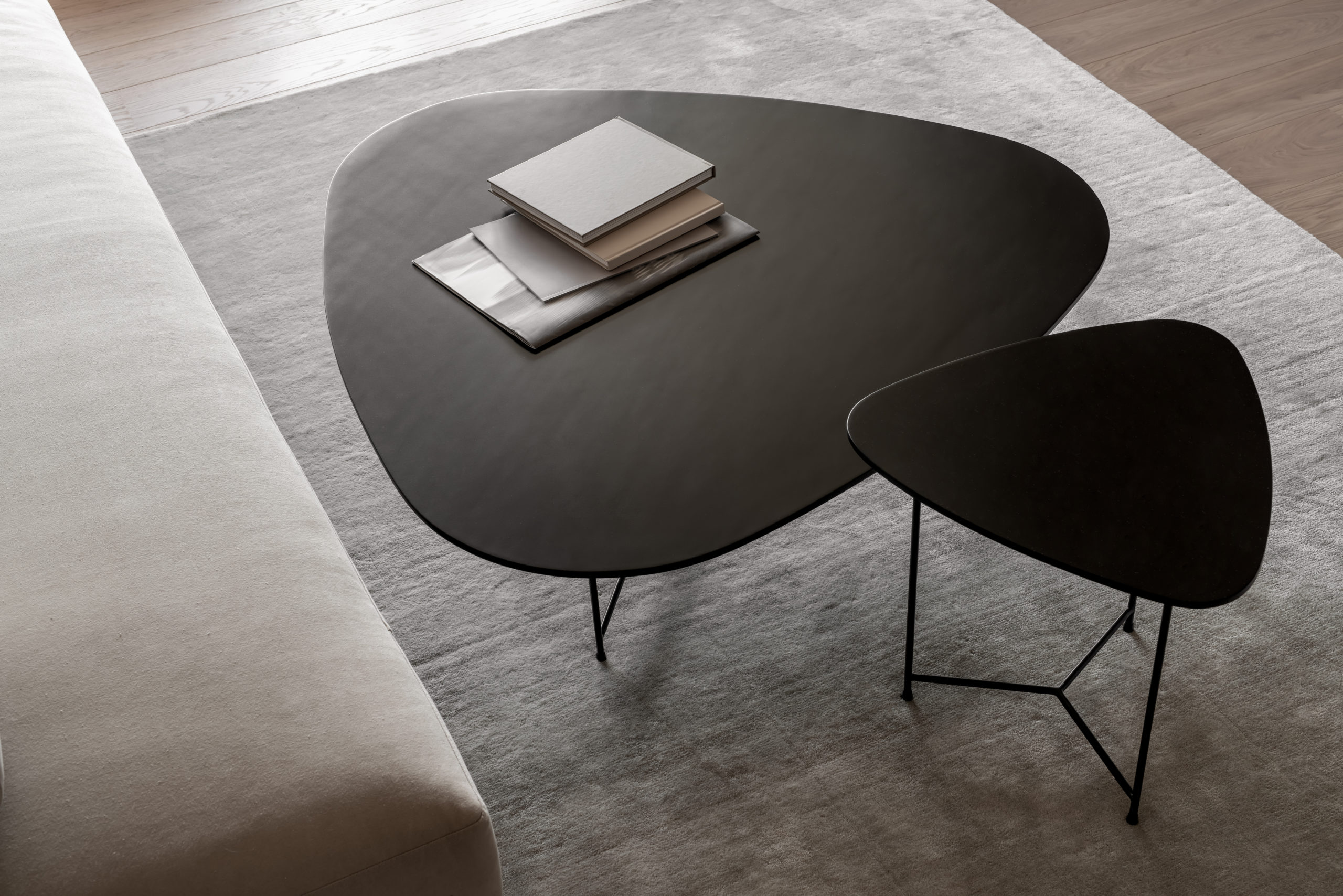 Metal black tables with books in modern interior